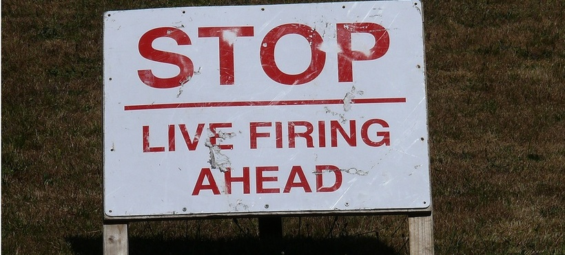 """STOP Life firing ahead"" reads a sign on a rifle range used by cadets in Northumbria."