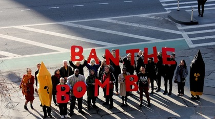Campaigners outside the Un buildings in New York with the slogan ban the bomb