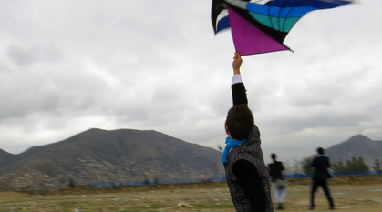 Abdulhai with a kite in Afghanistan