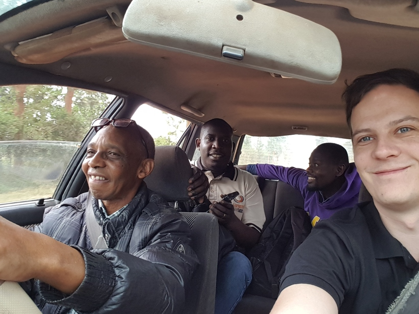 On the way to Gicumbi, Rwanda. Roads there are bumpy, but when you share the car with Rwandan peace activists, it's surely not boring. Sezeli, a peace campaigner and genocide survivor, is driving. Photo: Tobias Wellner