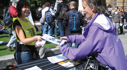 A woman handing out flyers