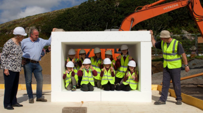 Children celebrate the beginning of a building project in Scotland