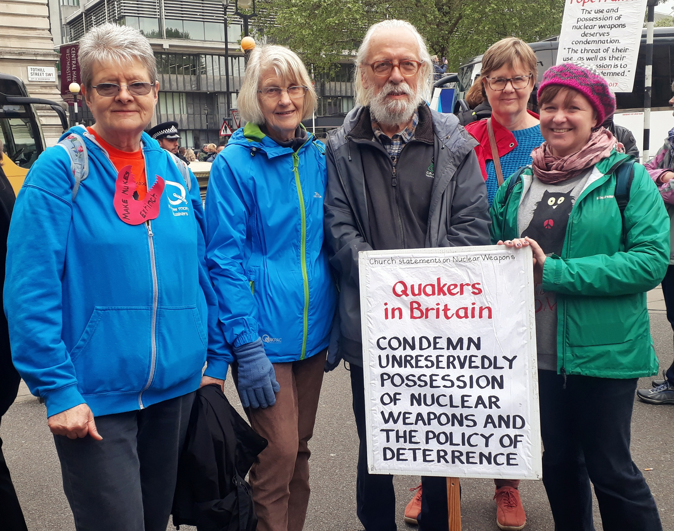 Quakers standing outside Westminster Abbey holding banners saying peace or Quakers for peace