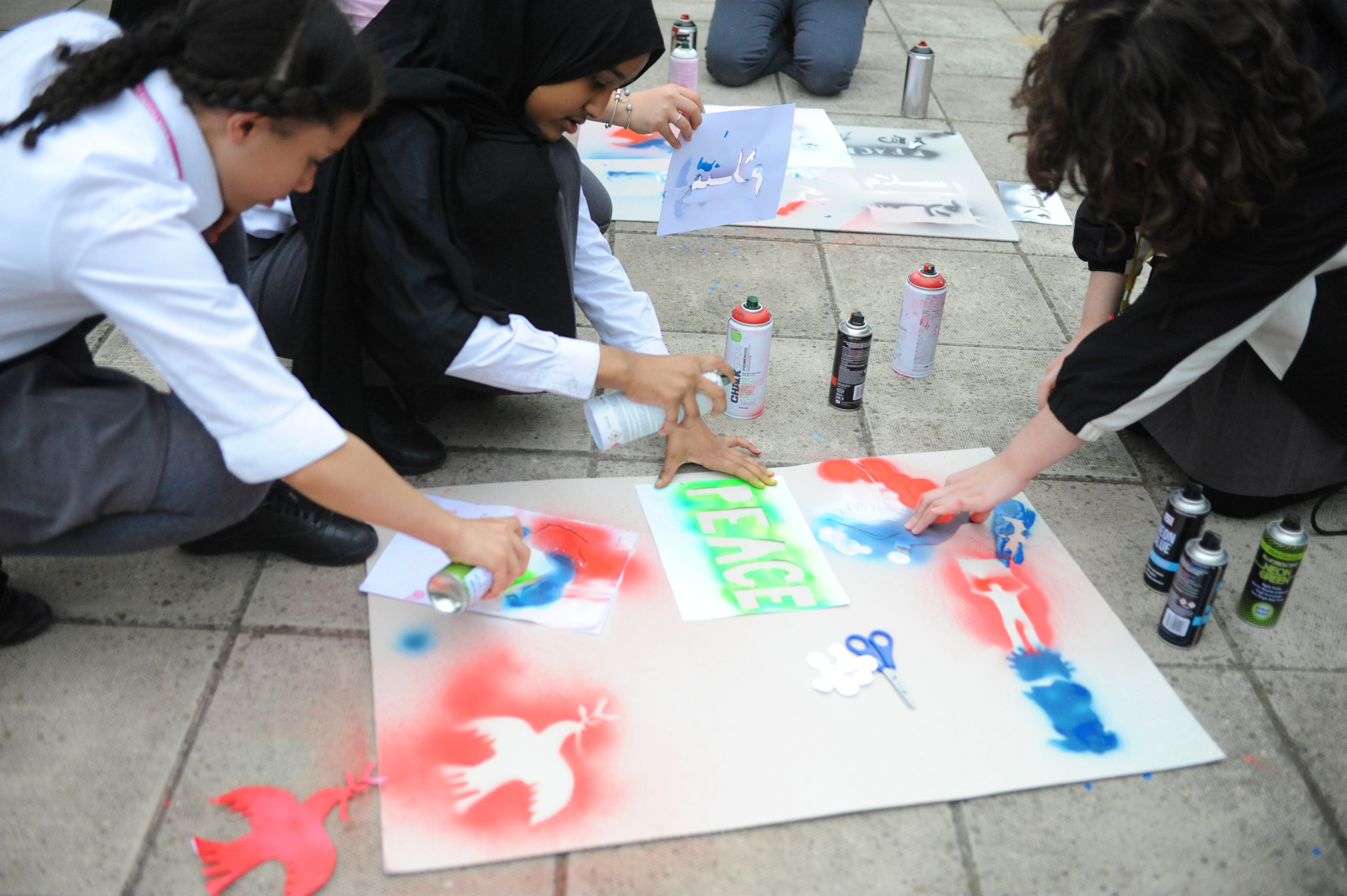 4 pupils spray graffiti doves