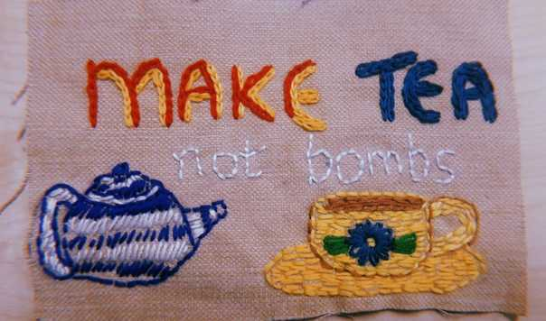 stitches on pot say make tea not bombs