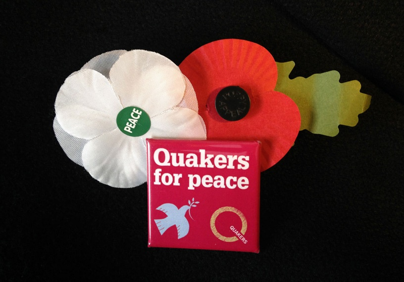 red,white poppies and peace badge