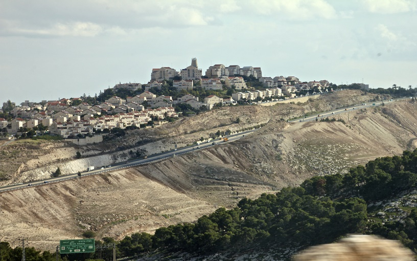 hilltop settlement, massive barrier wall, olive groves
