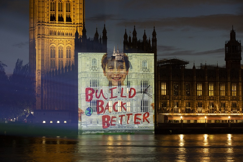 child holds placard says to PM build Back Better
