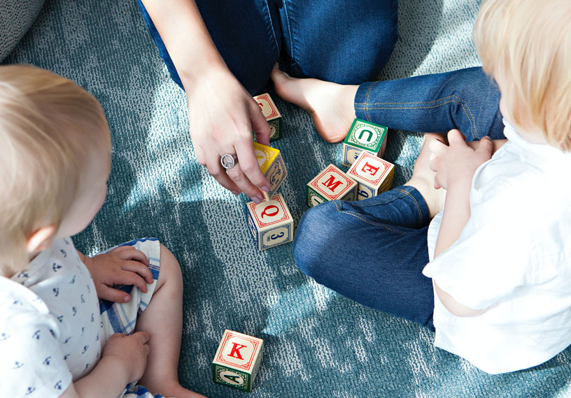 small children playing with blocks